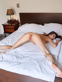Stunning Russian Brunette Leona Mia Reclines On Her Bed In A Sheer Negligee 14