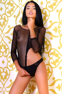 Gorgeous Asian babe Magen is a picture of eroticism in a fishnet top