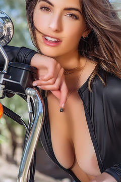 Lis Giolito Posing With A Motorcycle
